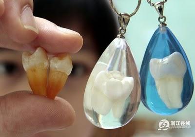 Pingente de dente